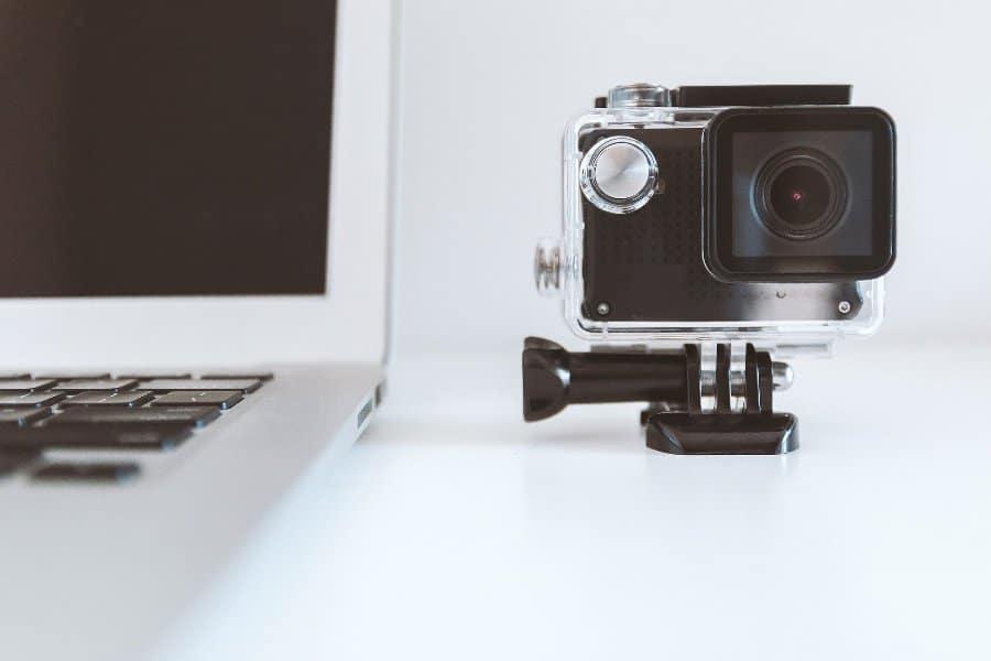 Go Pro camera beside a laptop