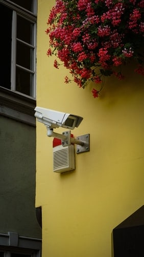 Security camera mounted in an exterior wall